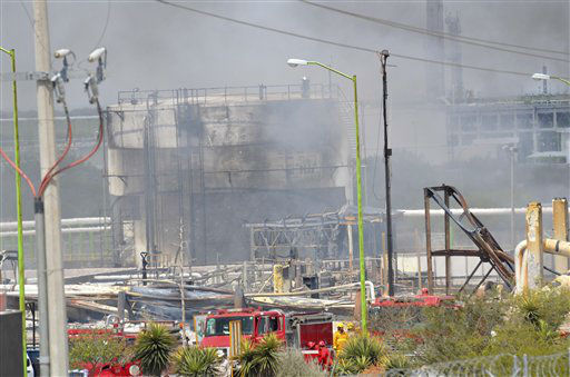 Damaged structures can be seen after an explosion ripped through a gas pipeline distribution center in Reynosa, Mexico near Mexico&#39;s border with the United States, Tuesday Sept. 18, 2012. Mexico&#39;s state-owned oil company, Petroleos Mexicanos, also known as Pemex said the fire had been extinguished and the pipeline had been shut off but ten people were killed during the incident. &#40;AP Photo&#47;El Manana de Reynosa&#41; <span class=meta>(AP Photo&#47; El Manana de Reynosa)</span>