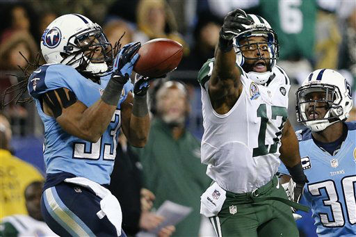 Tennessee Titans safety Michael Griffin &#40;33&#41; intercepts a pass intended for New York Jets wide receiver Braylon Edwards &#40;17&#41; in the fourth quarter of an NFL football game, Monday, Dec. 17, 2012, in Nashville, Tenn. The Titans won 14-10. At right is Titans cornerback Jason McCourty &#40;30&#41;. &#40;AP Photo&#47;Joe Howell&#41; <span class=meta>(AP Photo&#47; Joe Howell)</span>