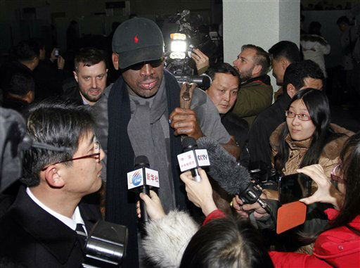 Flamboyant former NBA star Dennis Rodman is surrounded by journalists upon arrival at Pyongyang Airport, North Korea, Tuesday, Feb. 26, 2013. The American known as &#34;The Worm&#34; arrived in Pyongyang, becoming an unlikely ambassador for sports diplomacy at a time of heightened tensions between the U.S. and North Korea. &#40;AP Photo&#47;Kim Kwang Hyon&#41; <span class=meta>(AP Photo&#47; Kim Kwang Hyon)</span>