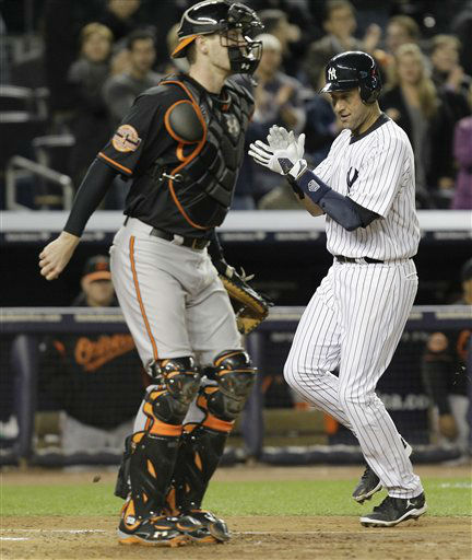 "<div class=""meta ""><span class=""caption-text "">New York Yankees' Derek Jeter, right, claps as he runs past Baltimore Orioles catcher Matt Wieters to score on an double by Ichiro Suzuki during the sixth inning of Game 5 of the American League division baseball series, Friday, Oct. 12, 2012, in New York. (AP Photo/Kathy Willens) (AP Photo/ Kathy Willens)</span></div>"