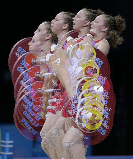 In this multiple exposure photo, Annie Moniqui of Canada competes during the women&#39;s 58-kg, group B, weightlifting competition at the 2012 Summer Olympics, Monday, July 30, 2012, in London. &#40;AP Photo&#47;Hassan Ammar&#41; <span class=meta>(AP Photo&#47; Hassan Ammar)</span>