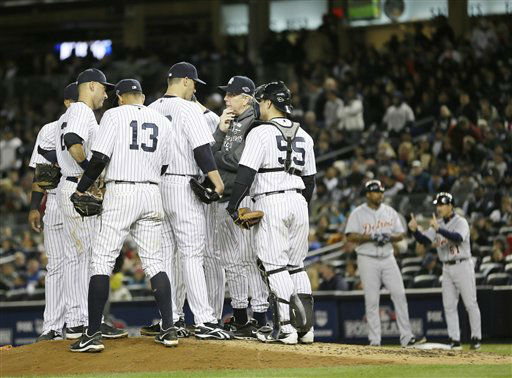 New York Yankees pitching coach Larry Rothschild, second from right, speaks with pitcher Andy Pettitte in the sixth inning during Game 1 of the American League championship series against the Detroit Tigers Saturday, Oct. 13, 2012, in New York. &#40;AP Photo&#47;Matt Slocum&#41; <span class=meta>(AP Photo&#47; Matt Slocum)</span>