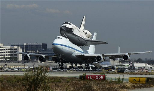 "<div class=""meta image-caption""><div class=""origin-logo origin-image ""><span></span></div><span class=""caption-text"">The Space Shuttle Endeavour atop a modified 747 lands at Los Angeles International Airport on Friday, Sept. 21, 2012 in Los Angeles, Endeavour will be permanently displayed at the California Science Center in Los Angeles. (AP Photo/Kevork Djansezian, Pool)</span></div>"