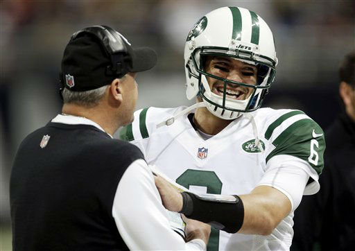 New York Jets quarterback Mark Sanchez, right, smiles as he talks with head coach Rex Ryan on the sidelines after a touchdown by running back Bilal Powell during the fourth quarter of an NFL football game against the St. Louis Rams, Sunday, Nov. 18, 2012, in St. Louis. &#40;AP Photo&#47;Tom Gannam&#41; <span class=meta>(AP Photo&#47; Tom Gannam)</span>