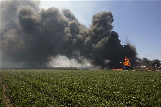 "<div class=""meta ""><span class=""caption-text "">Flames and smoke rise from chemical storage tanks near a strawberry farm in Camarillo, Calif., Thursday, May 2, 2013. A wildfire fanned by gusty Santa Ana winds raged along the fringes of Southern California communities on Thursday, forcing evacuation of homes and a university while setting recreational vehicles ablaze. (AP Photo/Ringo H.W. Chiu) (AP Photo/ Ringo H.W. Chiu)</span></div>"