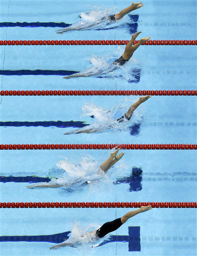 Swimmers compete in a women&#39;s 200 butterfly swimming heat at the Aquatics Centre in the Olympic Park during the 2012 Summer Olympics in London, Tuesday, July 31, 2012. &#40;AP Photo&#47;Lee Jin-man&#41; <span class=meta>(AP Photo&#47; Lee Jin-man)</span>