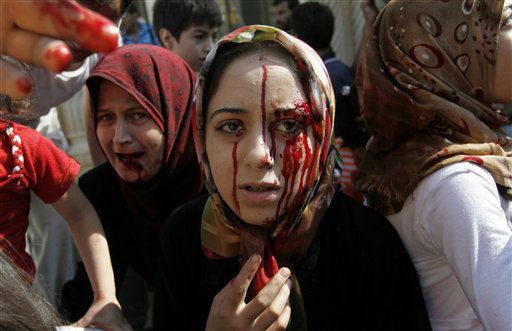 "<div class=""meta ""><span class=""caption-text "">Injured Syrian women arrive at a field hospital after an air strike hit their homes in the town of Azaz on the outskirts of Aleppo, Syria, Wednesday, Aug. 15, 2012. (AP Photo/ Khalil Hamra) (AP Photo/ Khalil Hamra)</span></div>"