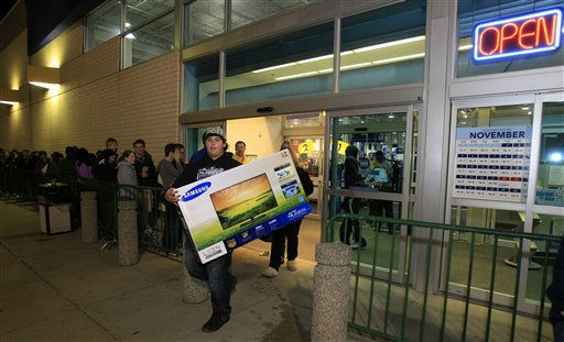 Christian Adorno, 13, walks out of a Best Buy with a 40-inch television Friday, Nov. 23, 2012, in Mayfield Heights, Ohio. The store opened at 12 a.m. on Friday. &#40;AP Photo&#47;Tony Dejak&#41; <span class=meta>(AP Photo&#47; Tony Dejak)</span>