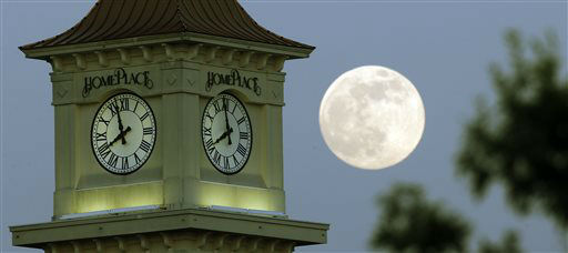 A &#34;supermoon&#34; rises behind the Home Place clock tower in Prattville, Ala., Saturday, June 22, 2013. The biggest and brightest full moon of the year graces the sky early Sunday as our celestial neighbor swings closer to Earth than usual. While the moon will appear 14 percent larger than normal, sky watchers won&#39;t be able to notice the difference with the naked eye. Still, astronomers say it&#39;s worth looking up and appreciating the cosmos. &#40;AP Photo&#47;Dave Martin&#41; <span class=meta>(AP Photo&#47; Dave Martin)</span>