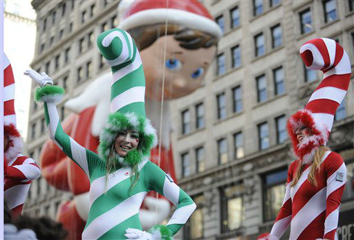 Candy Cane girls pass by Herald Square in front of the Elf on the Shelf balloon in celebration of the 86th annual Macy&#39;s Thanksgiving Day Parade,Thursday, Nov 22, 2012, in New York &#40;AP Photo&#47; Louis Lanzano&#41; <span class=meta>(AP Photo&#47; Louis Lanzano)</span>