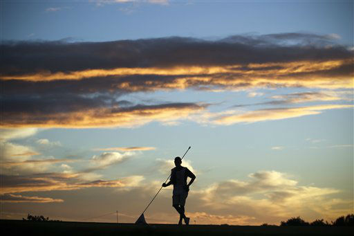 A caddie stands with the flag of the 9th hole during the first round of the Portugal Masters golf tournament at the Victoria golf course in Vilamoura, southern Portugal, Thursday, Oct. 11, 2012. &#40;AP Photo&#47;Francisco Seco&#41; <span class=meta>(AP Photo&#47; Francisco Seco)</span>