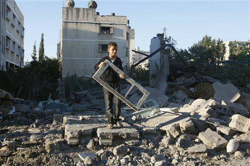 "<div class=""meta ""><span class=""caption-text "">A Palestinian boy holds a window pane taken from a damaged house hit in an Israeli strike, in Gaza City, Thursday, Nov. 15, 2012. Israeli aircraft, tanks and naval gunboats pounded the Hamas-ruled Gaza Strip and rocket salvoes thudded into southern Israel, as residents on both sides of the frontier holed up at home in anticipation of heavy fighting on the second day of Israel's offensive against Islamic militants. (AP Photo/Hatem Moussa) (AP Photo/ Hatem Moussa)</span></div>"