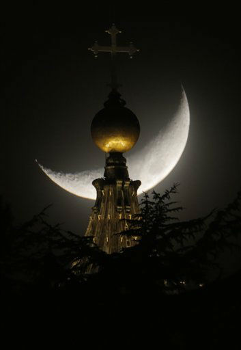 The moon is seen behind a dome of St. Peter&#39;s Basilica at the Vatican, Saturday, March 16, 2013. Pope Francis offered intimate insights Saturday into the moments after his election, telling journalists that he was immediately inspired to take the name of St. Francis of Assisi because of his work for peace and the poor ? and that he himself would like to see &#34;a poor church and a church for the poor.&#34;  &#40;AP Photo&#47;Dmitry Lovetsky&#41; <span class=meta>(AP Photo&#47; Dmitry Lovetsky)</span>