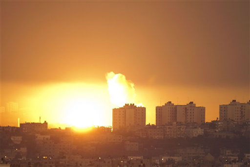 Explosion and smoke rise following an Israeli air strike in the northern Gaza Strip, seen from the Israel Gaza Border, southern Israel, Thursday, Nov. 15, 2012. &#40;AP Photo&#47;Ariel Schalit&#41; <span class=meta>(AP Photo&#47; Ariel Schalit)</span>