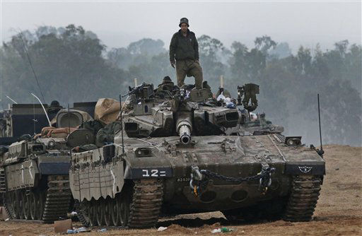 "<div class=""meta ""><span class=""caption-text "">An Israeli soldier stands on a tank at a staging area near the Israel Gaza Strip Border, southern Israel, early Tuesday, Nov. 20, 2012. U.N. Secretary-General Ban Ki-moon is urging Israeli forces and Gaza militants to hold their fire, warning that a further escalation of the seven-day-old conflict would endanger the entire region. (AP Photo/Lefteris Pitarakis)</span></div>"