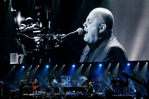 "<div class=""meta ""><span class=""caption-text "">This image released by Starpix shows Billy Joel at the 12-12-12 The Concert for Sandy Relief at Madison Square Garden in New York on Wednesday, Dec. 12, 2012. Proceeds from the show will be distributed through the Robin Hood Foundation. (AP Photo/Starpix, Dave Allocca) (AP Photo/ Dave Allocca)</span></div>"