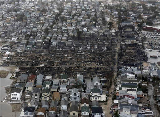This aerial photo shows burned-out homes in the Breezy Point section of the Queens borough New York after a fire on Tuesday, Oct. 30, 2012. The tiny beachfront neighborhood told to evacuate before Sandy hit New York burned down as it was inundated by floodwaters, transforming a quaint corner of the Rockaways into a smoke-filled debris field. &#40;AP Photo&#47;Mike Groll&#41; <span class=meta>(AP Photo&#47; Mike Groll)</span>