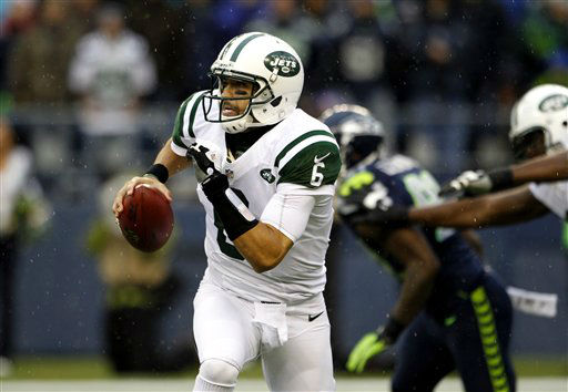 New York Jets quarterback Mark Sanchez looks to pass against the Seattle Seahawks during the second half of an NFL football game, Sunday, Nov. 11, 2012, in Seattle. &#40;AP Photo&#47;Elaine Thompson&#41; <span class=meta>(AP Photo&#47; Elaine Thompson)</span>