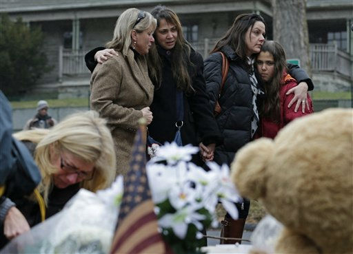 "<div class=""meta image-caption""><div class=""origin-logo origin-image ""><span></span></div><span class=""caption-text"">Women embrace at the site of a makeshift memorial for school shooting victims at the village of Sandy Hook in Newtown, Conn., Sunday, Dec. 16, 2012. A gunman opened fire at Sandy Hook Elementary School in the town, killing 26 people, including 20 children before killing himself on Friday. (AP Photo/Charles Krupa) (AP Photo/ Charles Krupa)</span></div>"