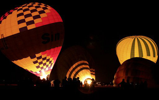 "<div class=""meta ""><span class=""caption-text "">FILE - In this Friday, Nov. 23, 2012 file photo, tourists wait their turns to ascend in hot air balloons before sunrise in Luxor, Egypt. A hot air balloon flying over Egypt's ancient city of Luxor caught fire and crashed into a sugar cane field outside al-Dhabaa village, just west of the city of Luxor,  Egypt, Tuesday, Feb. 26, 2013, killing at least 19 foreign tourists, a security official said. Hot air ballooning, usually at sunrise over the famed Karnak and Luxor temples as well as the Valley of the Kings, is a popular pastime for tourists visiting Luxor. (AP Photo/Nariman El-Mofty, File) (AP Photo/ Nariman El-Mofty)</span></div>"