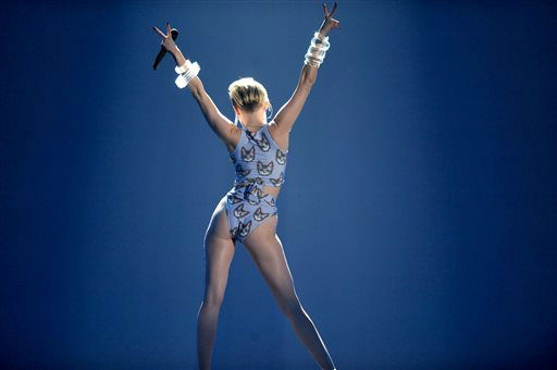 Miley Cyrus performs on stage at the American Music Awards at the Nokia Theatre L.A. Live on Sunday, Nov. 24, 2013, in Los Angeles. (Photo by John Shearer/Invision/AP)