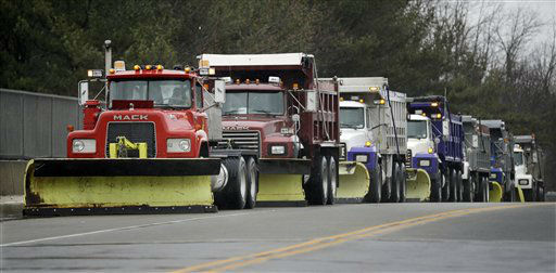A row of trucks with snowplows are parked in the rain alone a road  in Allentown, N.J., Friday, Feb. 8, 2013, as the region waits for a predicted snow storm.The light rain that fell Friday was expected to turn to snow in time for the evening rush. A blizzard warning for northeast New Jersey called for as much as 14 inches of snow. Up to 10 inches were possible for most of the state, with 2 to 5 inches in south Jersey.  &#40;AP Photo&#47;Mel Evans&#41; <span class=meta>(AP Photo&#47; Mel Evans)</span>