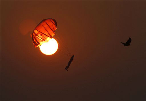 "<div class=""meta image-caption""><div class=""origin-logo origin-image ""><span></span></div><span class=""caption-text"">A toy parachute is shot in the air to attract people at sunset on Juhu Chowpatty beach in Mumbai, India, Sunday, Nov. 4, 2012. (AP Photo/Rajesh Kumar Singh) (AP Photo/ Rajesh Kumar Singh)</span></div>"
