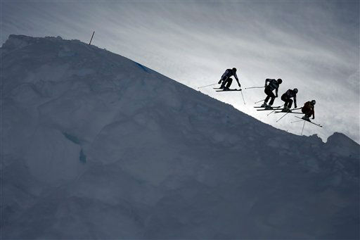Skiers perform during the men&#39;s ski cross World Cup event of Val Thorens, French Alps, Wednesday, Dec. 19, 2012. &#40;AP Photo&#47;Laurent Cipriani&#41; <span class=meta>(AP Photo&#47; Laurent Cipriani)</span>