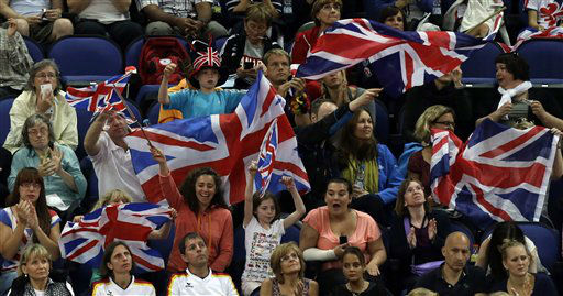 Spectators wave the national flag of Great Britain as they watch the Artistic Gymnastic women&#39;s qualifications at the 2012 Summer Olympics, Sunday, July 29, 2012, in London. &#40;AP Photo&#47;Julie Jacobson&#41; <span class=meta>(AP Photo&#47; Julie Jacobson)</span>
