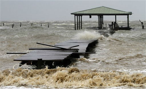 Waves tear apart a pier along the Mobile Bay near Dauphin Island on Tuesday, August 28, 2012. Alabama took a glancing blow from Hurricane Isaac on Tuesday as it headed toward landfall in the northwestern Gulf of Mexico, but the storm still threatened the coast with high winds, torrential rain and pounding surf. &#40;AP Photo&#47;Butch Dill&#41; <span class=meta>(AP Photo&#47; Butch Dill)</span>