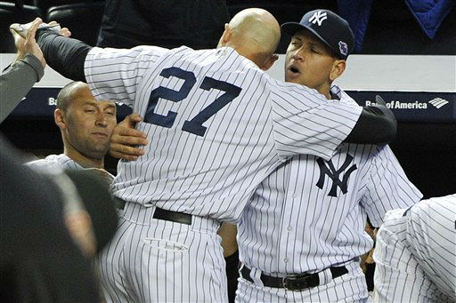 New York Yankees&#39; Alex Rodriguez, right, hugs Raul Ibanez &#40;27&#41; as Derek Jeter watches at left after Ibanez pinch-hit a home run in place of Rodriguez during the ninth inning of Game 3 of their American League division baseball series against the Baltimore Orioles, Wednesday, Oct. 10, 2012, in New York. The Yankees won 3-2. &#40;AP Photo&#47;Bill Kostroun&#41; <span class=meta>(AP Photo&#47; Bill Kostroun)</span>