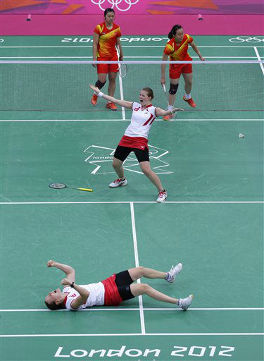 Denmark&#39;s Kamilla Rytter Juhl, foreground, and Christinna Pedersen, center, celebrate after beating China&#39;s Zhao Yunlei, right, and Tian Qing, at a women&#39;s doubles  badminton match of the 2012 Summer Olympics, Tuesday, July 31, 2012, in London. &#40;AP Photo&#47;Saurabh Das&#41; <span class=meta>(AP Photo&#47; Saurabh Das)</span>