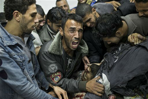 "<div class=""meta ""><span class=""caption-text "">A Palestinian man cries next the body of a dead relative in the morgue of Shifa Hospital in Gaza City, Sunday, Nov. 18, 2012. President Barack Obama on Sunday defended Israel's airstrikes on the Gaza Strip, but he warned that escalating the offensive with Israeli ground troops could deepen the death toll and undermine any hope of a peace process with the Palestinians. (AP Photo/Bernat Armangue) (AP Photo/ Bernat Armangue)</span></div>"