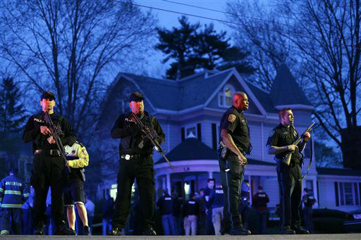 "<div class=""meta ""><span class=""caption-text "">Police officers guard the entrance to Franklin street where there is an active crime scene search for the suspect in the Boston Marathon bombings, Friday, April 19, 2013, in Watertown, Mass. Gunfire erupted Friday night amid the manhunt for the surviving suspect in the Boston Marathon bombing, and police in armored vehicles and tactical gear rushed into the Watertown neighborhood in a possible break in the case. (AP Photo/Matt Rourke) (AP Photo/ Matt Rourke)</span></div>"