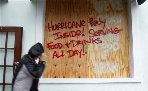 A person walks by a sign warning about Hurricane Isaac, in Key West, Fla., Sunday, Aug. 26, 2012. Isaac gained fresh muscle Sunday as it bore down on the Florida Keys, with forecasters warning it could grow into a dangerous Category 2 hurricane as it nears the northern Gulf Coast. &#40;Alan Diaz&#41; <span class=meta>(AP Photo&#47; Alan Diaz)</span>