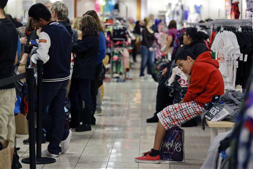 A teenage boy waits for his family to finish shopping at a J.C. Penney store, Friday, Nov. 23, 2012, in Las Vegas. Black Friday, the day when retailers traditionally turn a profit for the year, got a jump start this year as many stores opened just as families were finishing up Thanksgiving dinner. Stores are experimenting with ways to compete with online rivals like Amazon.com that can offer holiday shopping deals at any time and on any day.
