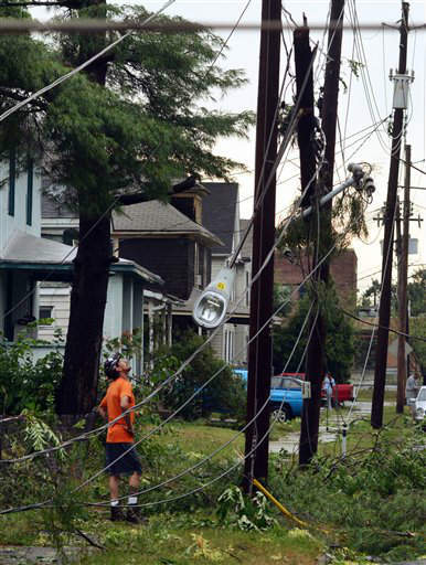 A man inspects the aftermath of a tornado that struck Elmira N.Y., Thursday, July 26, 2012. Power lines and trees were toppled and hospitals were placed on disaster alert but there were no immediate reports of injuries after a possible tornado hit the city of Elmira Thursday afternoon, Chemung County Office of Fire and Emergency Management spokeswoman Karen Miner said. &#40;AP Photo&#47;Heather Ainsworth&#41; <span class=meta>(AP Photo&#47; Heather Ainsworth)</span>