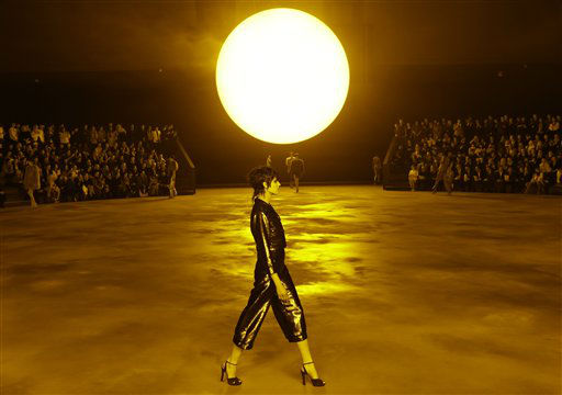 A model walks in front of a huge sun as spectators watch from an arena-style set-up during the Marc Jacobs Fall 2013 fashion show at Fashion Week in New York, Thursday, Feb. 14, 2013.  &#40;AP Photo&#47;Kathy Willens&#41; <span class=meta>(AP Photo&#47; Kathy Willens)</span>