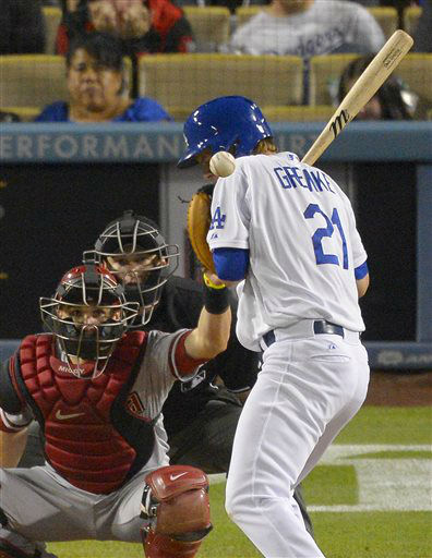 Los Angeles Dodgers&#39; Zack Greinke, right, is hit by a pitch as Arizona Diamondbacks catcher Miguel Montero catches during the seventh inning of their baseball game, Tuesday, June 11, 2013, in Los Angeles.  &#40;AP Photo&#47;Mark J. Terrill&#41; <span class=meta>(AP Photo&#47; Mark J. Terrill)</span>