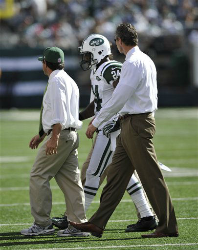 "<div class=""meta ""><span class=""caption-text "">In this Sept. 9, 2012 photo, New York Jets' Darrelle Revis (24) is ecsorted off the field after being injured on a play during the first half of an NFL football game against the Buffalo Bills, at MetLife Stadium in East Rutherford, N.J. The star cornerback suffered what the team called a ""mild concussion.""  (AP Photo/Bill Kostroun) (AP Photo/ Bill Kostroun)</span></div>"