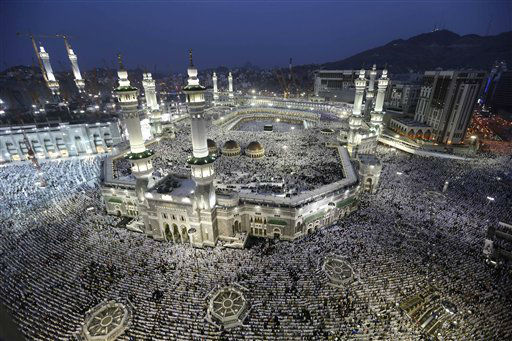 Muslim pilgrims circle the Kaaba as pray inside and outside the Grand mosque in Mecca, Saudi Arabia, Monday, Oct. 22, 2012. The annual Islamic pilgrimage draws three million visitors each year, making it the largest yearly gathering of people in the world. &#40;AP Photo&#47;Hassan Ammar&#41; <span class=meta>(AP Photo&#47; Hassan Ammar)</span>
