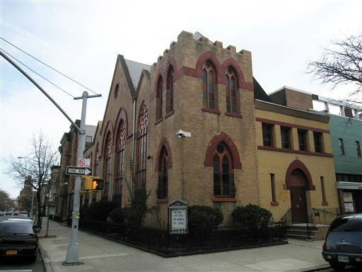 This April 7, 2013 image shows the Nazarene Congregational Church in Bedford-Stuyvesant, Brooklyn. Baseball great Jackie Robinson was close to the church?s assistant pastor, the Rev. Lacy Covington, and at one time Robinson, whose son struggled with drug addiction, made a speech in the church warning against the scourge of drugs. Robinson lived nearby for a time after joining the Brooklyn Dodgers, becoming the first African-American to play for a Major League Baseball team, a story that is told in a new movie, ?42.? &#40;AP Photo&#47;Beth J. Harpaz&#41; <span class=meta>(AP Photo&#47; Beth J. Harpaz)</span>