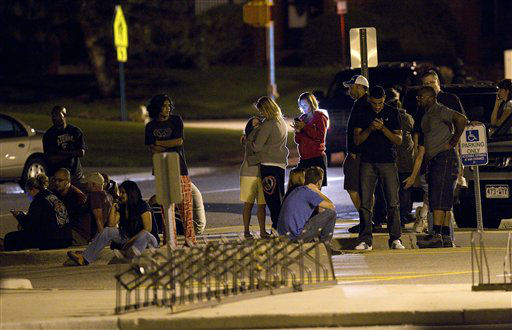 Family and friends wait outside Gateway High School where witnesses were brought for questioning after a shooting at a movie theater showing the Batman movie &#34;The Dark Knight Rises,&#34; Friday, July 20, 2012 in Aurora, Colo.  A gunman wearing a gas mask set off an unknown gas and fired into the crowded movie theater killing 12 people and injuring at least 50 others, authorities said. &#40;AP Photo&#47;Barry Gutierrez&#41; <span class=meta>(AP Photo&#47; Barry Gutierrez)</span>