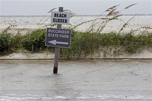 High tide and rising waves forced the closing of Buccanneer State Park and  Beach Boulevard in Waveland, Miss., as Isaac&#39;s winds and rain hit the Mississippi Gulf Coast, Tuesday, Aug. 28, 2012. The U.S. National Hurricane Center in Miami said Isaac became a Category 1 hurricane Tuesday with winds of 75 mph. It could get stronger by the time it&#39;s expected to reach the swampy coast of southeast Louisiana. &#40;AP Photo&#47;Rogelio V. Solis&#41; <span class=meta>(AP Photo&#47; Rogelio V. Solis)</span>