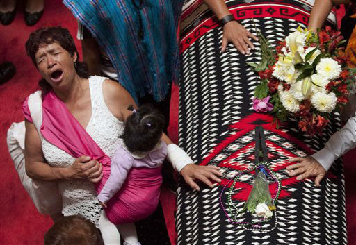 "<div class=""meta ""><span class=""caption-text "">ALTERNATIVE CROP OF MXAM102 - People mourn next to the draped casket of the late Mexican singer Chavela Vargas during her wake in the Palace of Fine Arts in Mexico City, Tuesday, Aug. 7, 2012. Chavela Vargas, who defied gender stereotypes to become one of the most legendary singers in Mexico, died Aug. 5 at age 93. (AP Photo/Alexandre Meneghini) (AP Photo/ Alexandre Meneghini)</span></div>"