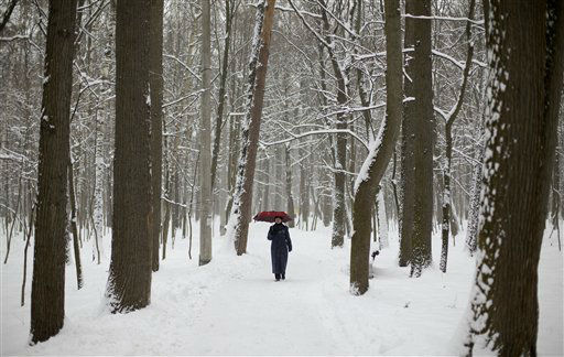 "<div class=""meta image-caption""><div class=""origin-logo origin-image ""><span></span></div><span class=""caption-text"">A woman walks in a snow-covered park in Moscow, Russia, Thursday, Nov. 29, 2012. A record-breaking snowfall in Moscow has disrupted flights, created havoc on the roads, and forecasters say the storm will rage until Friday morning. Moscow's city hall said the Russian capital hasn't seen a bigger snowfall in November in about 50 years. Over 70 flights were disrupted overnight. (AP Photo/Ivan Sekretarev) (AP Photo/ Ivan Sekretarev)</span></div>"