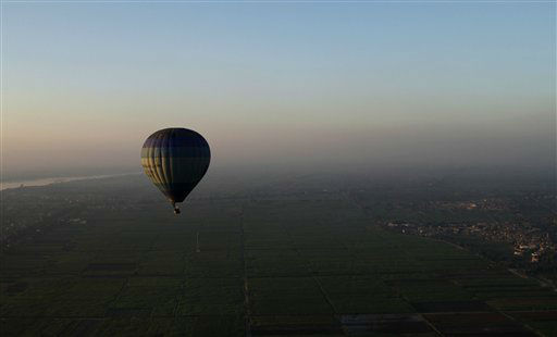 "<div class=""meta ""><span class=""caption-text "">FILE - In this Friday, Nov. 23, 2012 file photo, tourists ride a hot air balloon before sunrise in Luxor, Egypt. A hot air balloon flying over Egypt's ancient city of Luxor caught fire and crashed into a sugar cane field outside al-Dhabaa village, just west of the city of Luxor,  Egypt, Tuesday, Feb. 26, 2013, killing at least 19 foreign tourists, a security official said. (AP Photo/Nariman El-Mofty, File) (AP Photo/ Nariman El-Mofty)</span></div>"