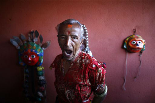 A Nepalese mask dancer yawns as he gets ready for Shikali festival in Khokana, outskirts of Katmandu, Nepal, Sunday, Oct. 21, 2012. Devotees sacrifice animals hoping to get the blessing of deities during this festival. &#40;AP Photo&#47;Niranjan Shrestha&#41; <span class=meta>(AP Photo&#47; Niranjan Shrestha)</span>