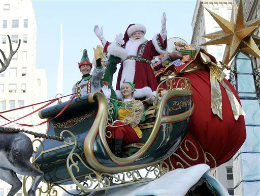 Santa Claus waves to the crowd at Herald Square during the 86th annual Macy&#39;s Thanksgiving Day Parade,Thursday, Nov 22, 2012, in New York &#40;AP Photo&#47; Louis Lanzano&#41; <span class=meta>(AP Photo&#47; Louis Lanzano)</span>
