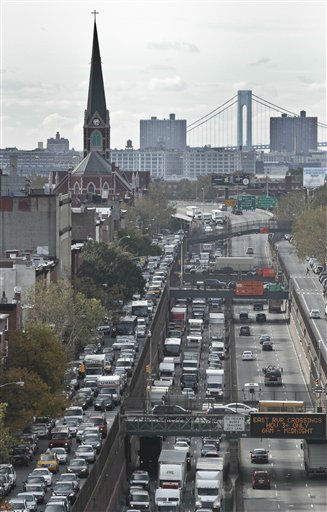"<div class=""meta ""><span class=""caption-text "">Traffic clogs Henry Street, left, and the Brooklyn-Queens Expressway on Thursday, Nov. 1, 2012, in Brooklyn, N.Y. (AP Photo/Bebeto Matthews) (AP Photo/ Bebeto Matthews)</span></div>"